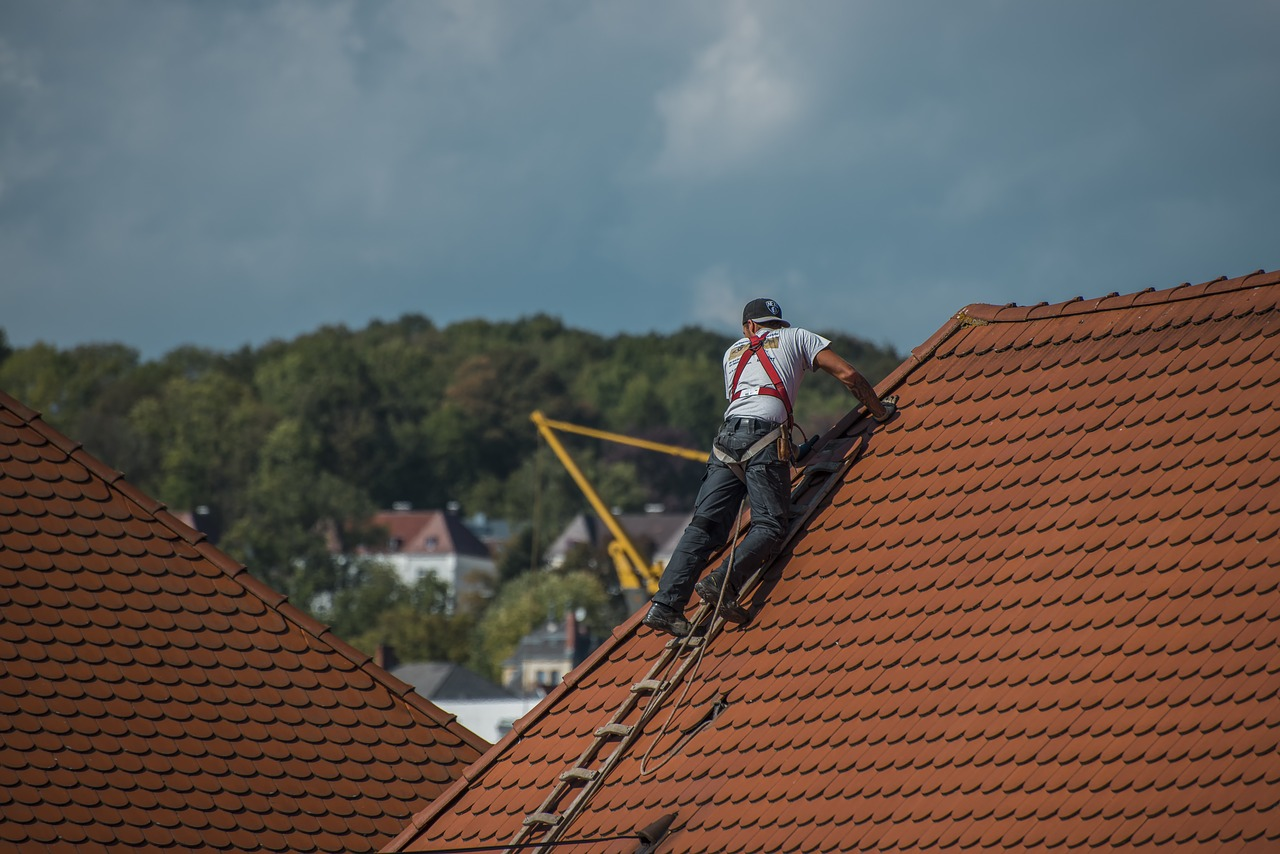 A roofer repairing a roof